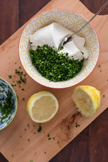 top down view on bowl with ricotta, lemon and herbs