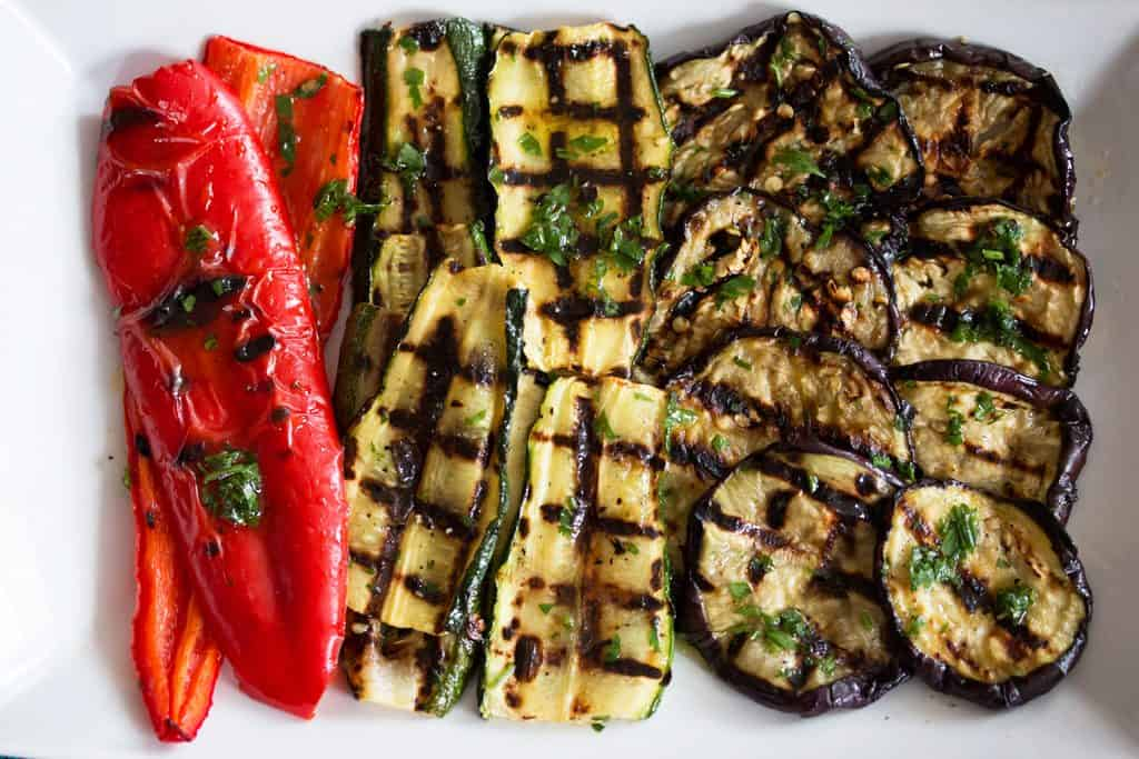 top down view on grilled vegetables on a white platter