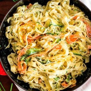 top down view on skillet with fettuccine in ricotta sauce