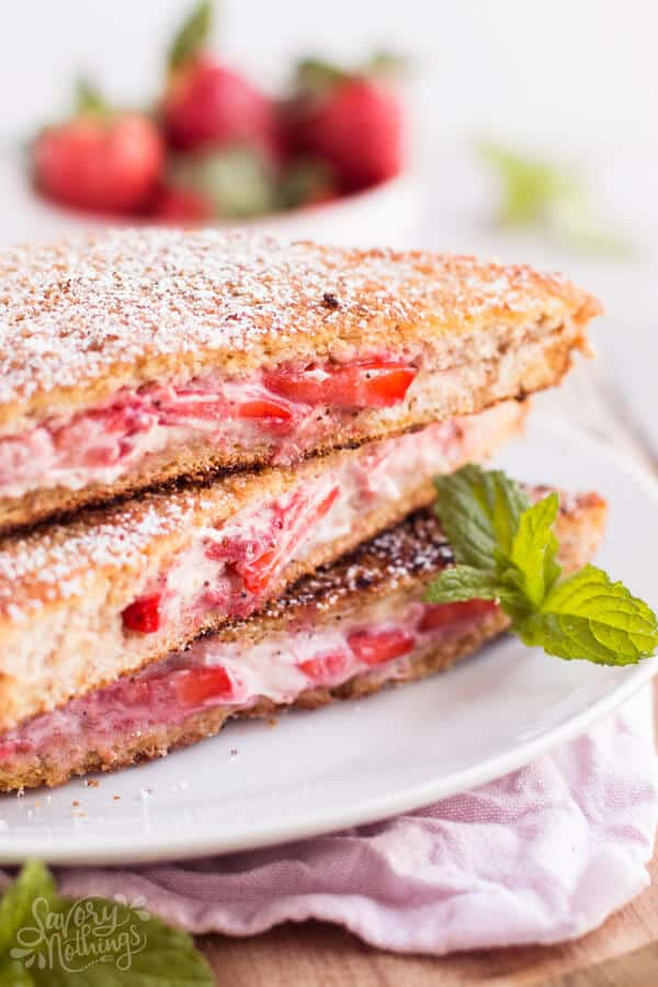 This Healthy Cream Cheese Strawberry Stuffed French Toast is made with whole grain bread, low fat cream cheese, maple syrup and strawberry slices.