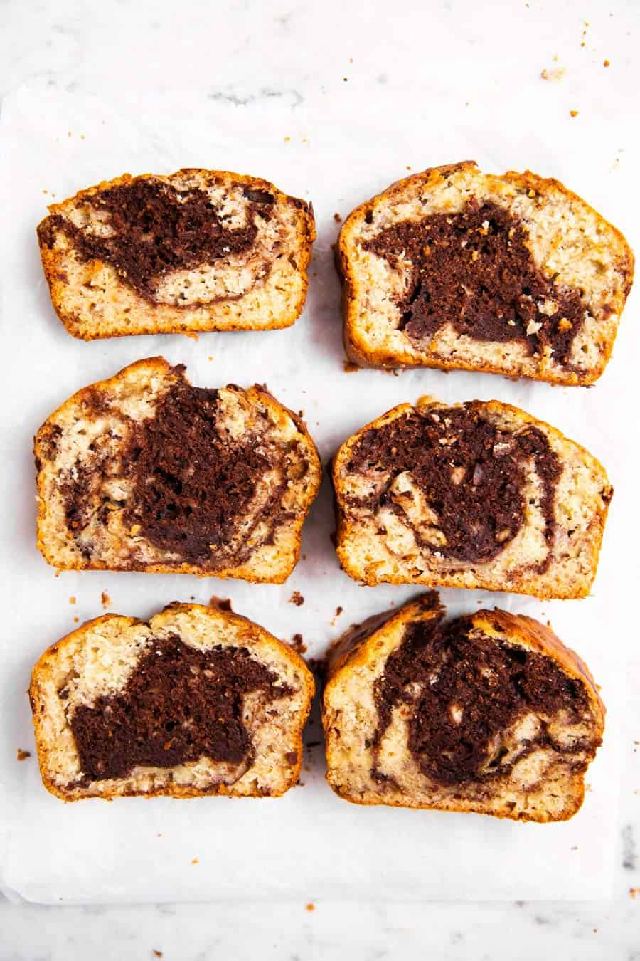 six sliced of chocolate marble banana bread on marble surface