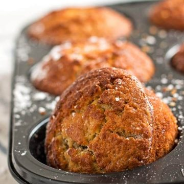 close up of apple muffin in muffin pan
