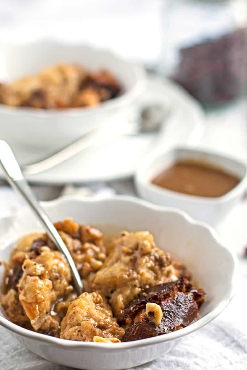 Whether you call it a crockpot or a slow cooker, this Cranberry Walnut Bread Pudding with Caramel Sauce is sure to please you! Not just because it's the best recipe in terms of deliciousness – it's also super quick and easy to whip up and the slow cooking technique will reward you with the most intense flavors in this traditional holiday dessert!
