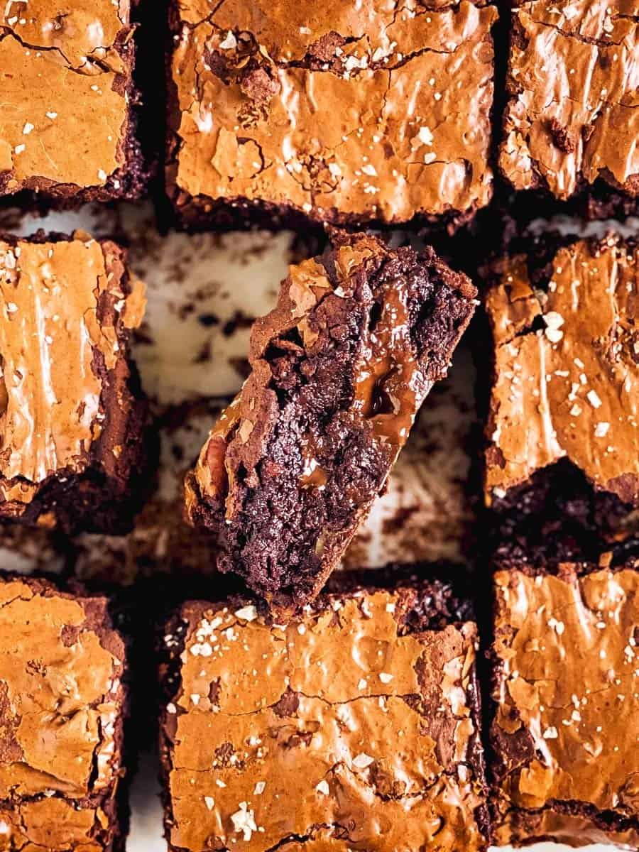 overhead view of sliced brownies with one edge facing upwards
