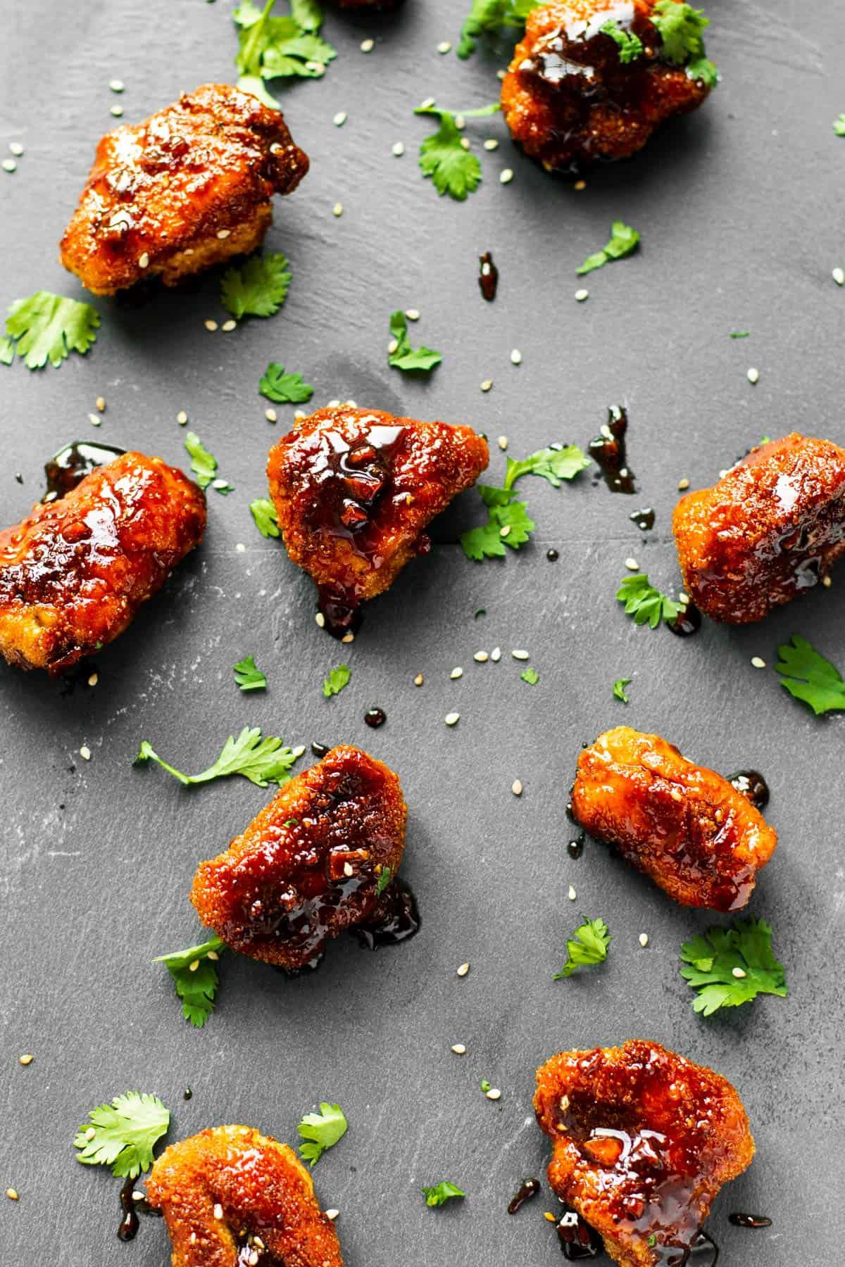 top down view on garlic chicken pieces on dark background