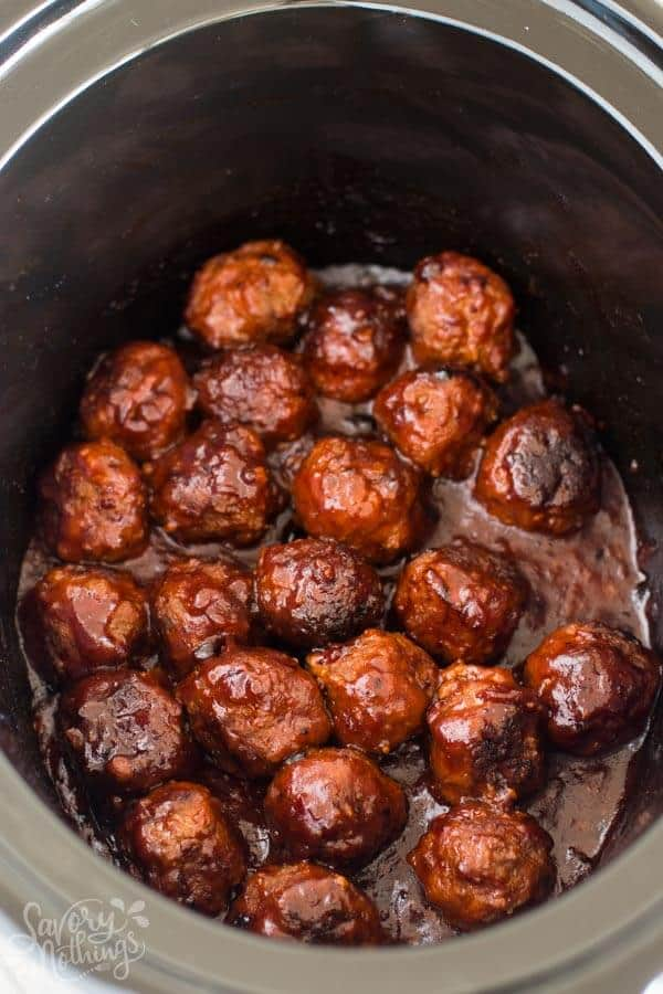 Easy homemade meatballs cooked in a delicious BBQ Sauce in the crockpot. They are a great appetizer for your next holiday party and they are perfect for Football Sunday or the Super Bowl as mini sliders. Serve them with mashed potatoes or rice as a simple dinner for families. Made with beef, breadcrumbs, seasoning and barbecue sauce. The best of comfort foods for fall and winter.