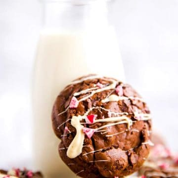 peppermint brownie cookie leaning against a bottle of milk