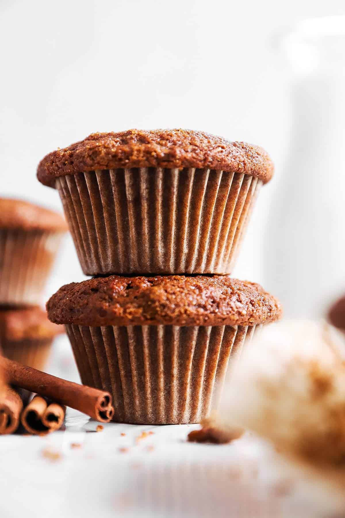 stack of gingerbread muffins in front of a milk bottle