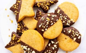 overhead photo of peanut butter shortbread cookies on white plate
