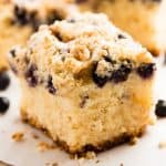 slice of lemon blueberry coffee cake on parchment paper