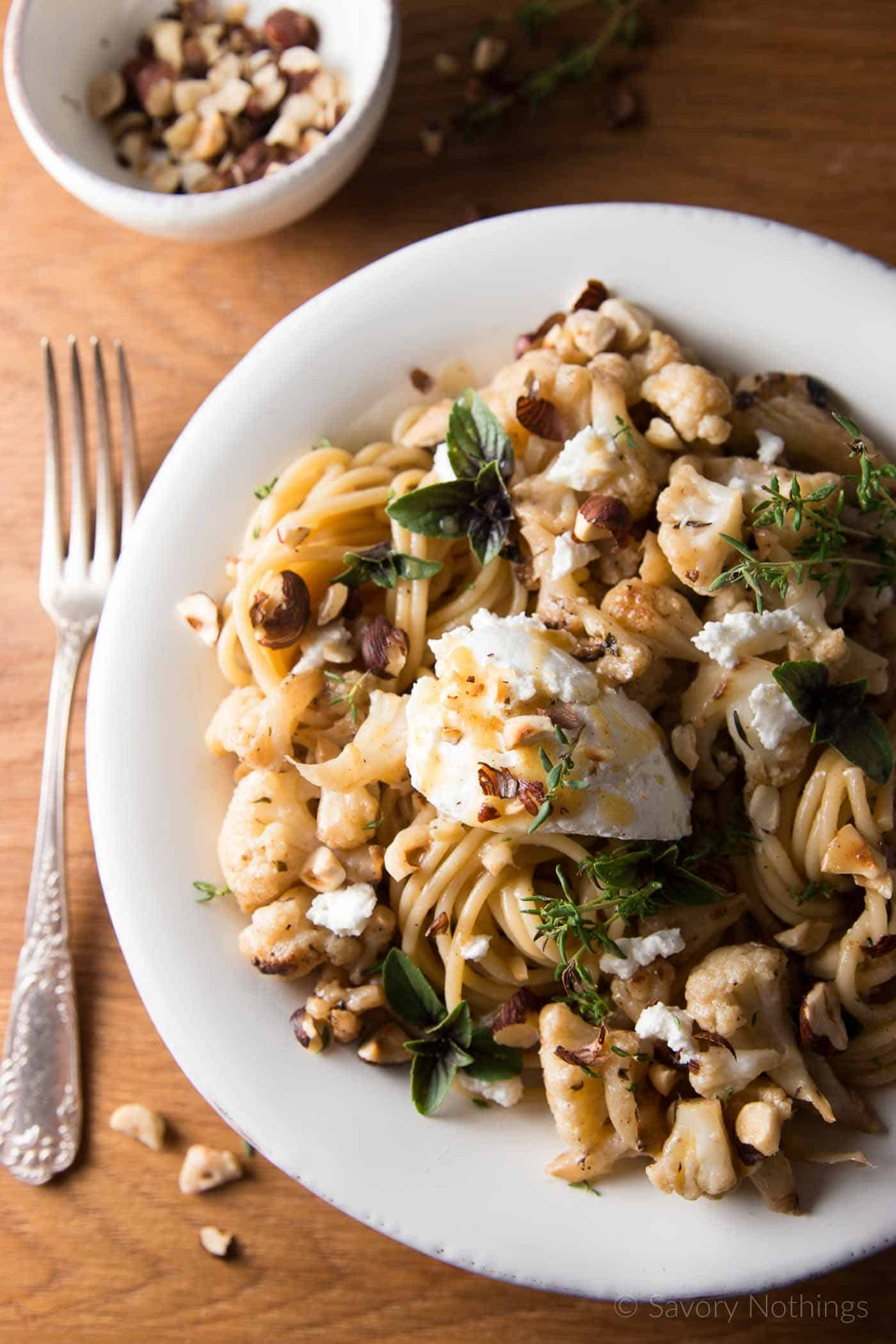 Roasted Cauliflower and Hazelnut Spaghetti Recipe - Decadent with roasted hazelnuts and browned butter, this quick dinner comes together in just 30 minutes. | savorynothings.com