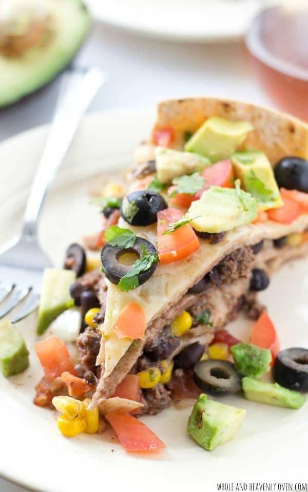 slice of enchilada pie on white plate