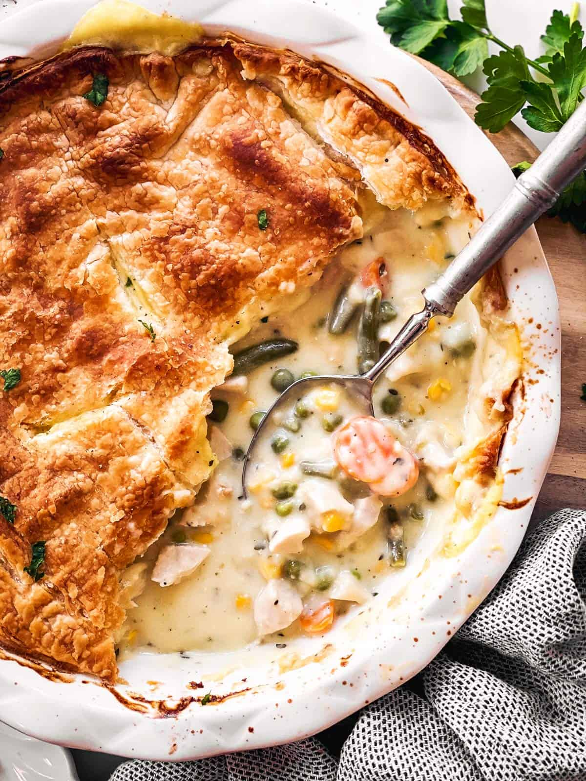 close up photo of spoon in turkey pot pie