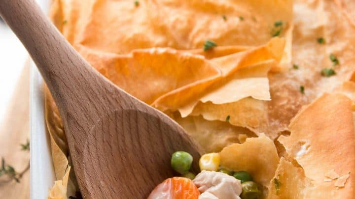 Use leftover turkey and frozen vegetables in this Healthy Easy Turkey Pot Pie recipe to serve a quick and light dinner. It uses phyllo sheets instead of puff pastry and there's no heavy cream OR butter in the filling! | savorynothings.com
