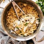 skillet with turkey tetrazzini surrounded by parmesan and parsley