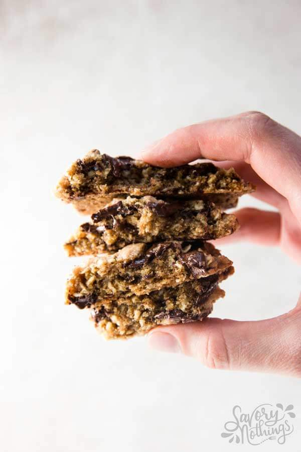 female hand holding  stack of oatmeal cookies
