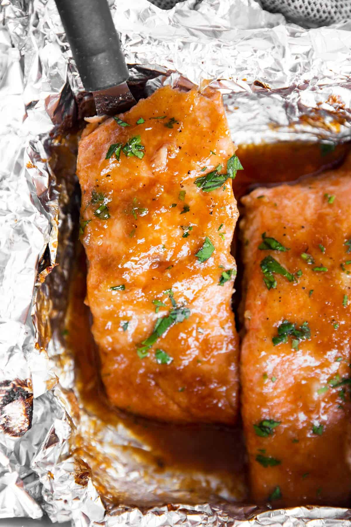 close up photo of honey garlic salmon in foil