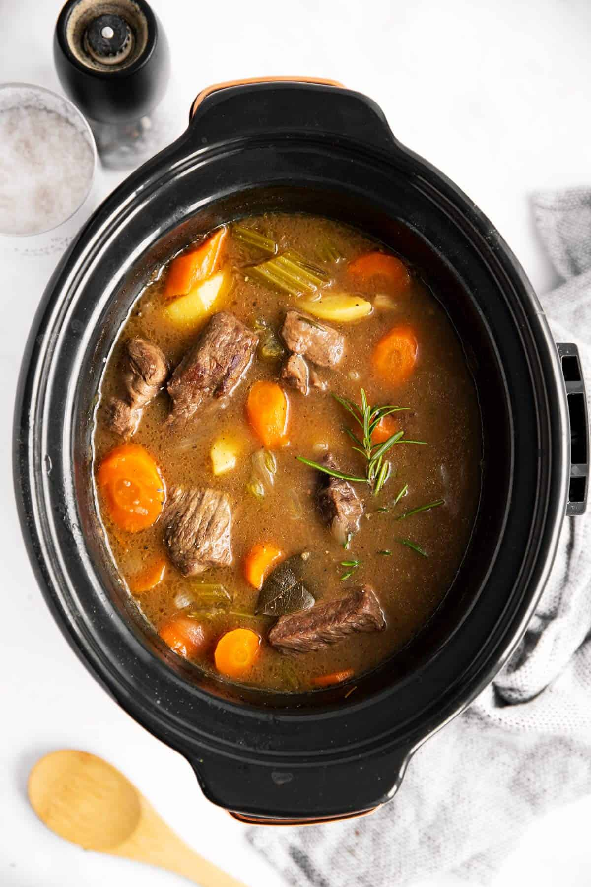 top down view of a slow cooker with beef stew inside