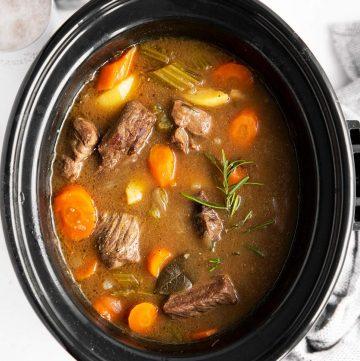 close up photo of crock with Irish beef stew inside