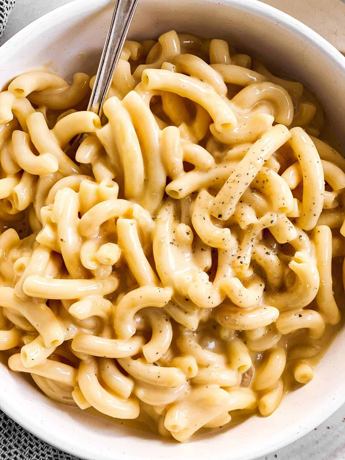 close up photo of Mac and cheese in a white bowl