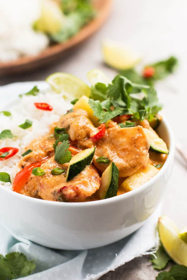 Thai shrimp curry with rice in white bowl