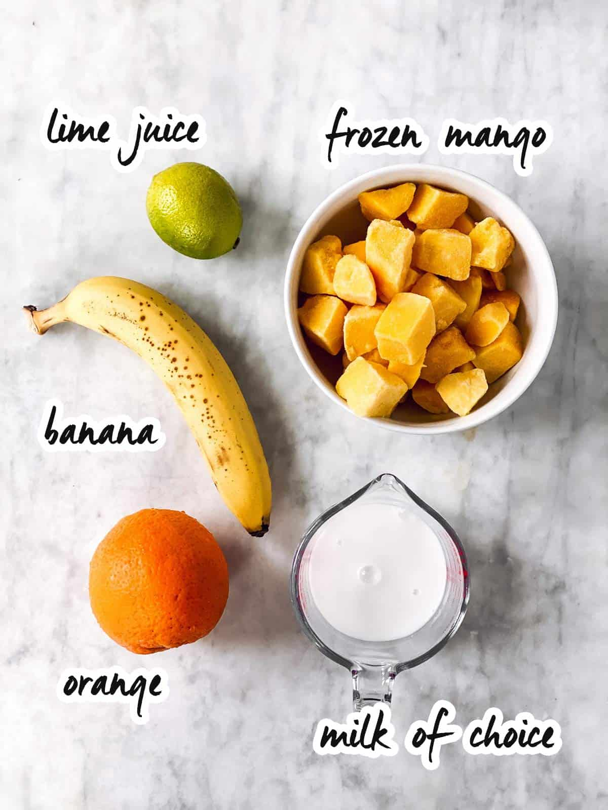 ingredients for a banana mango smoothie with text labels