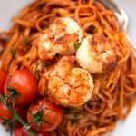 overhead closeup of shrimp on tomato pasta