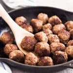 How to make meatballs rom scratch: Finished meatballs in skillet.