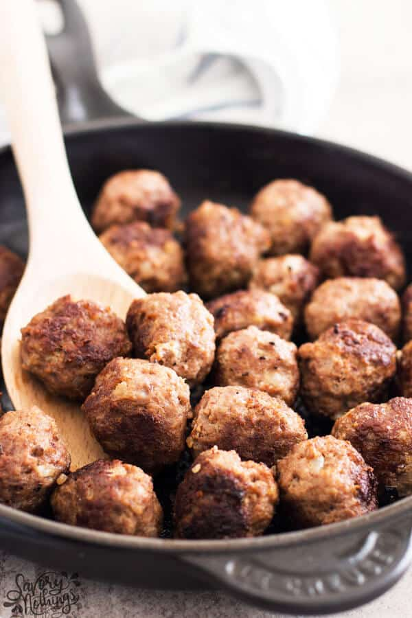 close up photos of meatballs in cast iron skillet