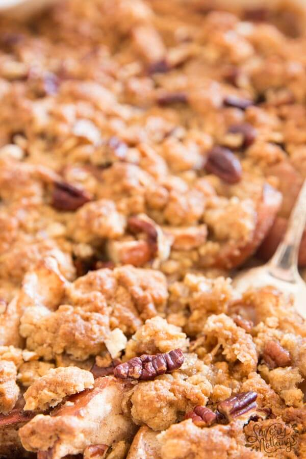 The simple topping for this quick apple crisp is made with butter, sugar, flour and oatmeal.