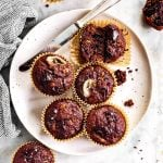 overhead view of chocolate banana muffins on white plate