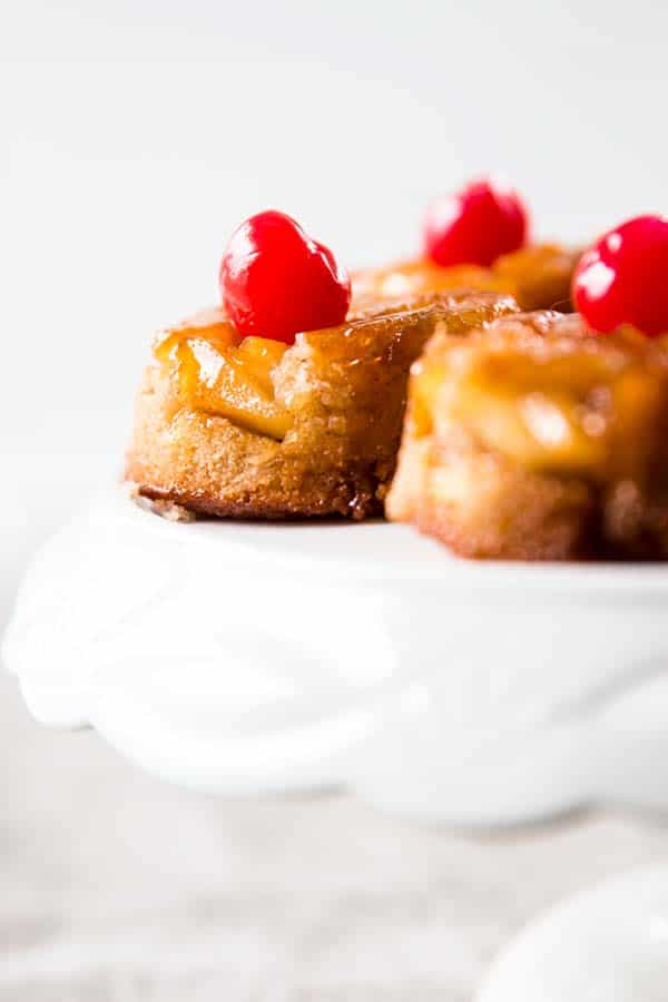 Homemade Pineapple Upside Down Cupcakes are so good! Made with a secret spice ingredient you would NEVER guess!