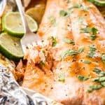 fork stuck into baked salmon