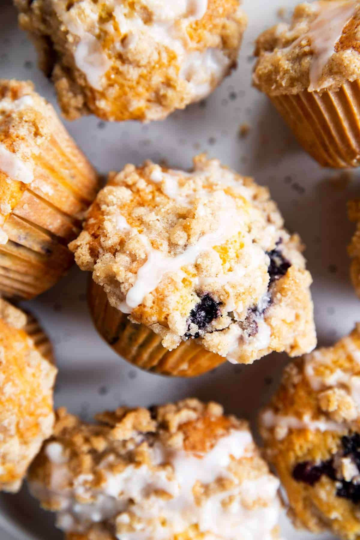 overhead close up of several blueberry muffins on plate