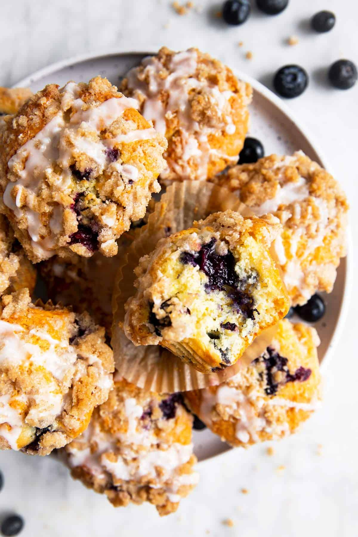 overhead view of blueberry muffins on white plate