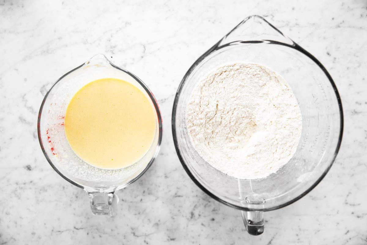 glass bowls with wet and dry ingredients for muffin batter