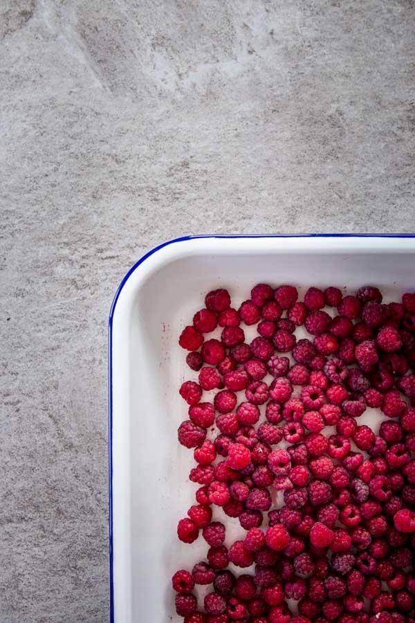 Fresh raspberries on a tray.