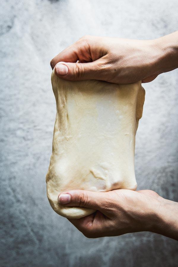 Windowpane test with challah bread dough.