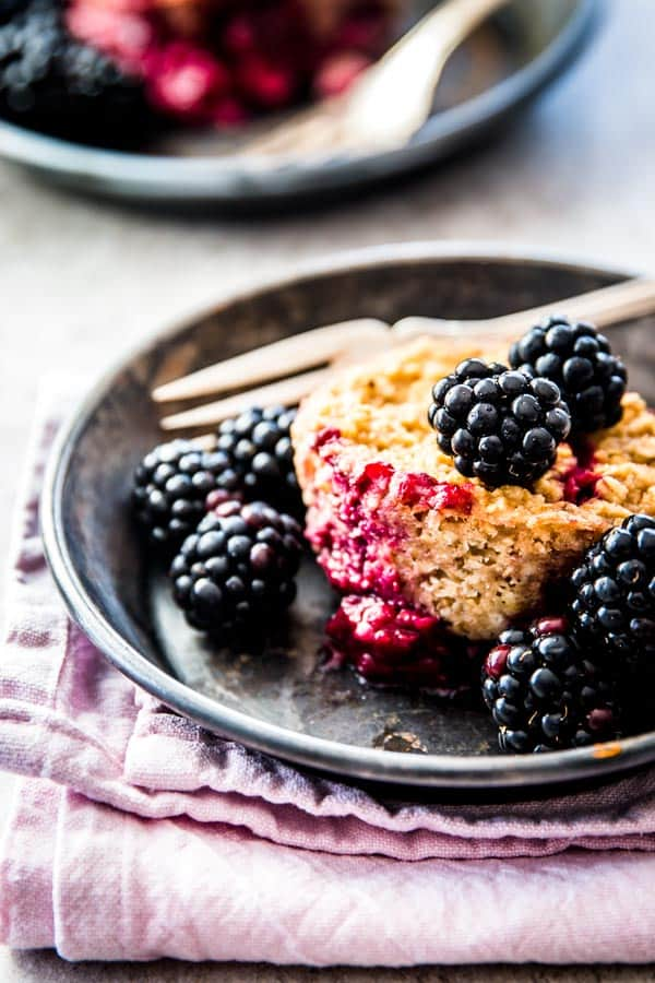 blackberry baked oatmeal cup on dark dish