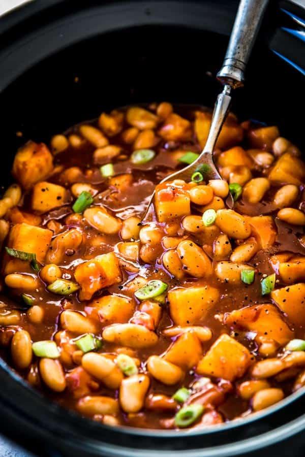 Crock Pot Baked Beans are a fun dish to bring to potlucks. Make them for your next gathering!