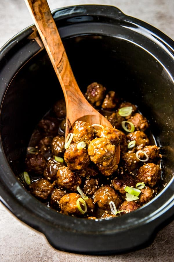 Honey Garlic Crockpot Meatballs are a great crowd-pleasing appetizer. Make them for Football Sunday!