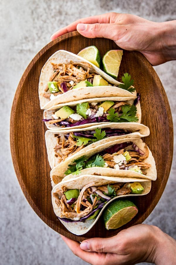 Serving pork carnitas as tacos is an easy way to make a delicious weeknight dinner. Try it tonight!