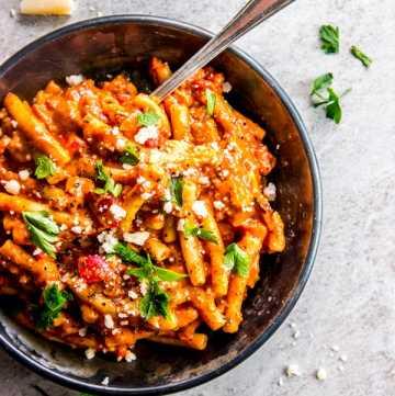 overhead view on Italian sausage pasta in black dish
