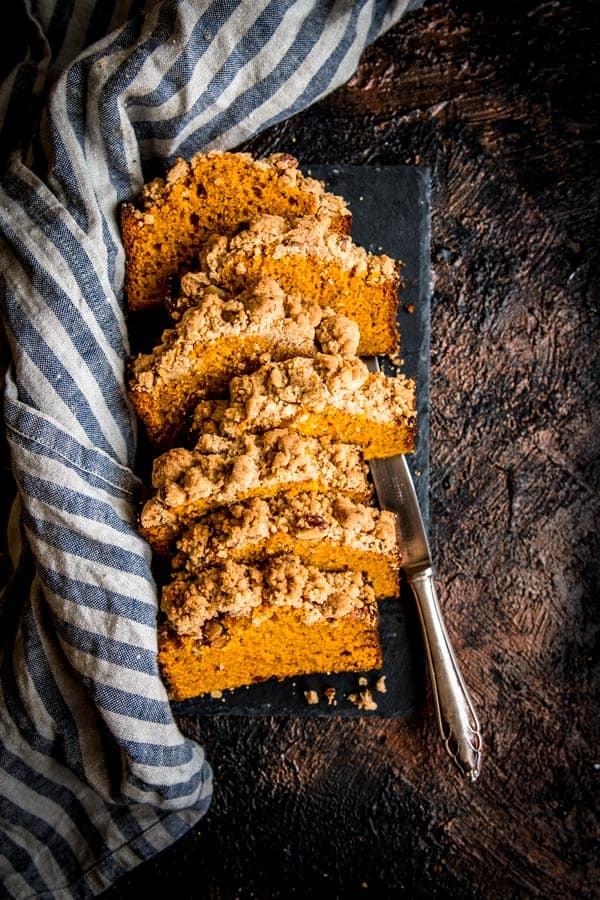 Cozy up for fall this year and celebrate the season with this cinnamon crumb pumpkin bread recipe. You won't believe how good it makes your house smell!