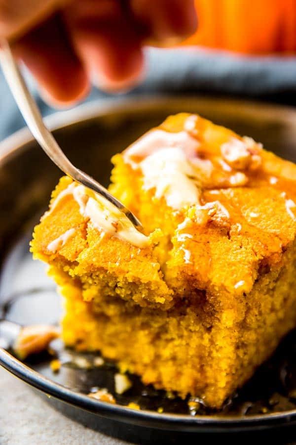 fork digging in slice of pumpkin cornbread