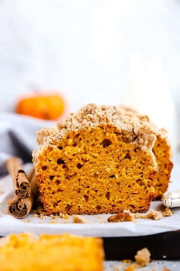 sliced loaf of pumpkin bread on a wooden board