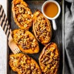 overhead view of black aluminum pan with twice baked sweet potato skins