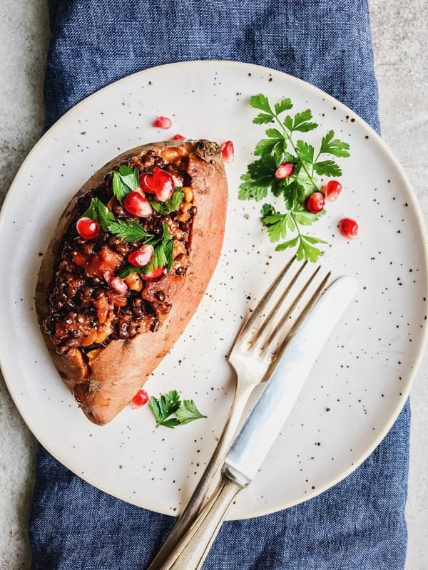 Hearty Lentil Walnut Vegan Stuffed Sweet Potatoes are the perfect vegan and gluten free dish for the holidays. Make them for Thanksgiving this year!