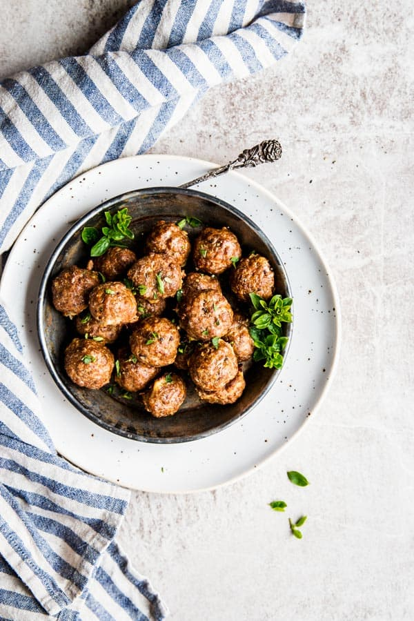 Oven baked meatballs in a bowl, ready to be served.