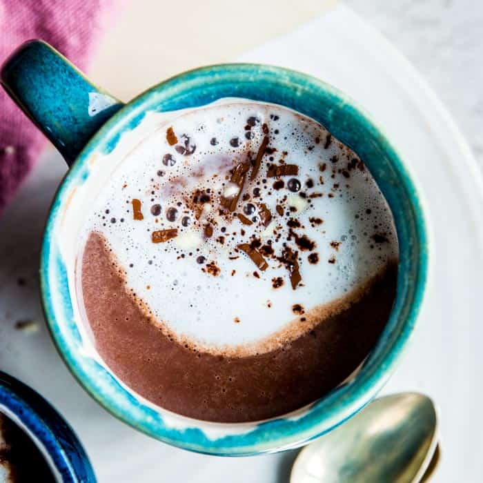 close up of blue mug with hot chocolate